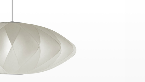 Close up of the shade of a Nelson Saucer CrissCross Bubble Pendant lamp.
