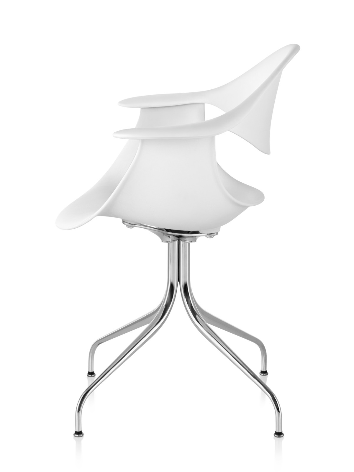 Profile view of a white Nelson Swag Leg Armchair, showing the molded plastic shell and curved steel legs.