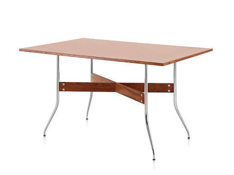 A rectangular Nelson Swag Leg Table in a medium wood finish, showing X-shaped walnut stretchers between tubular steel legs.