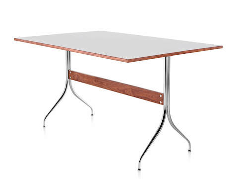 A rectangular Nelson Swag Leg Table with a white top, showing a single walnut stretcher between tubular steel legs.