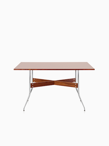 A Nelson Swag Leg Table with a medium veneer top.