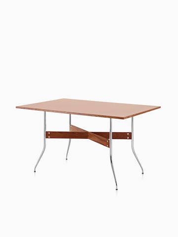 A Nelson Swag Leg Table with a medium veneer top. Select to go to the Nelson Swag Leg Desk and Tables product page.
