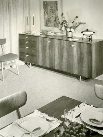 A vintage photo from the 1950s showing an early example of a Nelson Thin Edge chest and cabinet combination.