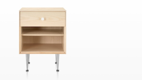 A Nelson Thin Edge bedside table with a light finish, white knob, and slim aluminum legs.