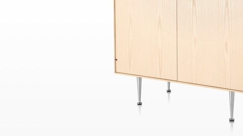 Close view of the slim aluminum legs on a Nelson Thin Edge storage unit.