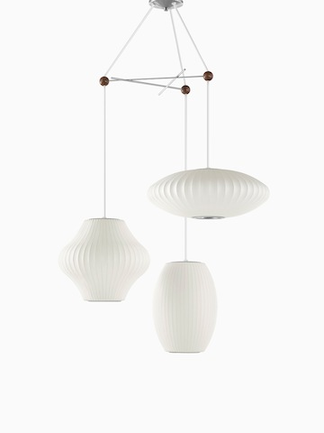 Three white hanging lamps.