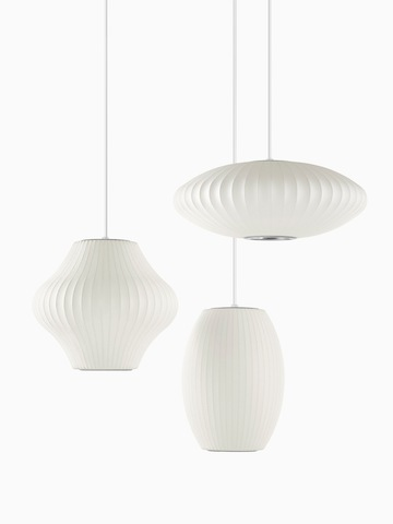 Three white hanging lamps. Select to go to the Nelson Triple Bubble Lamp Fixture product page.