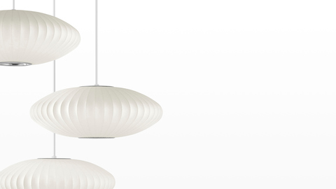 Three Nelson Saucer Bubble Pendants hanging from the same fixture.
