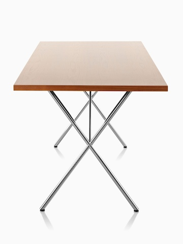 A Nelson X-Leg Table with a light veneer top and chrome legs, viewed from the narrow end.