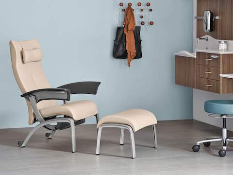 A tan Nala Patient Chair and Ottoman in exam room.