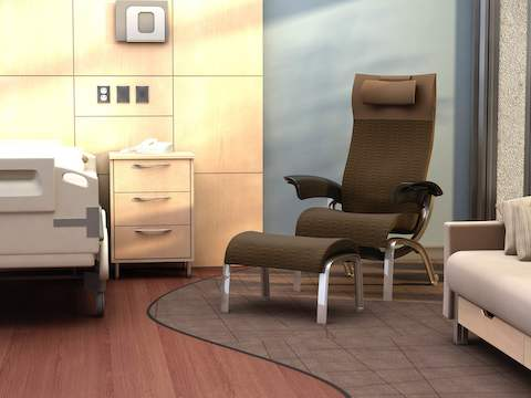 A brown Nala Patient Chair and Ottoman in patient room.