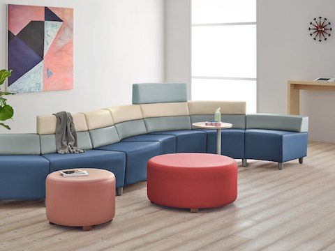 A waiting area with a Steps Lounge System and Steps Ottoman in brightly colored textiles.