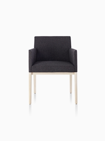 Black Nessel Chair with arms and light wood base, viewed from the front.