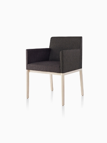 Black Nessel Chair with arms and light wood base, viewed from the front at an angle.