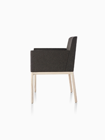 Black Nessel Chair with arms and light wood base, viewed from the side.