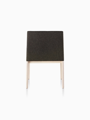 Black Nessel Chair with light wood base, viewed from the back.