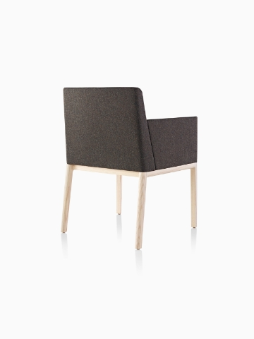 Black Nessel Chair with arms and light wood base, viewed from the back at an angle.