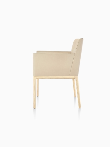 Tan Nessel Chair with arms and light wood base, viewed from the side.