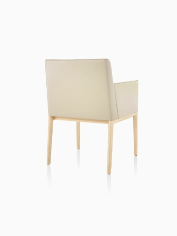 Tan Nessel Chair with arms, viewed from the back at an angle.