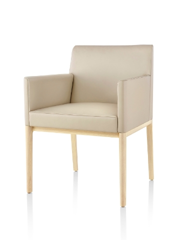Tan Nessel Chair with arms and light wood base, viewed from the front at an angle.
