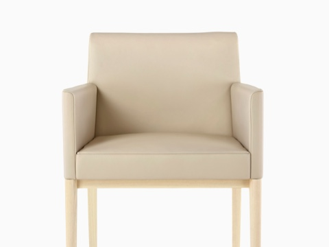 Tan Nessel Chair with arms and light wood base, viewed from the front.
