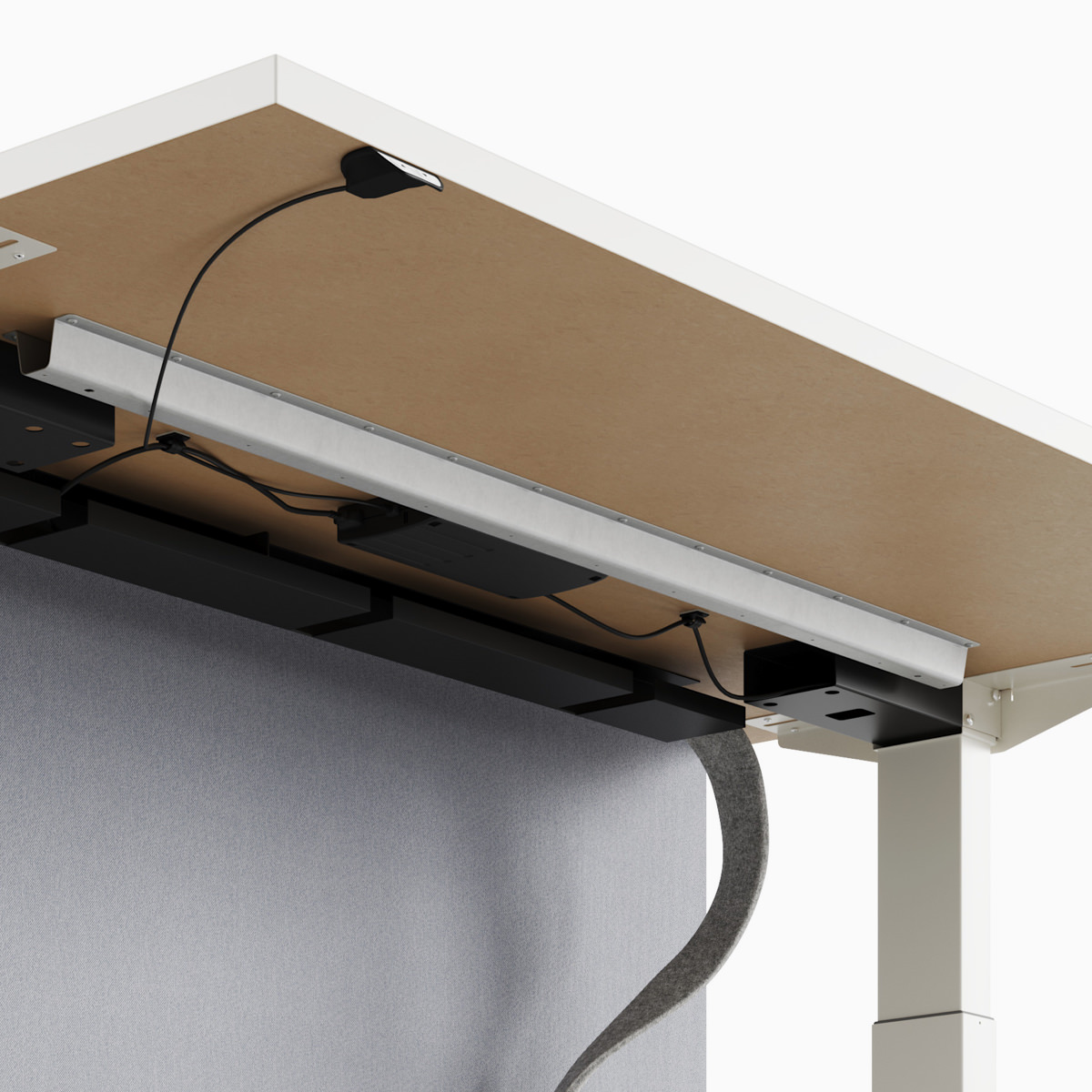 A close-up view of a Nevi Link standing desk system's under-surface cable management.