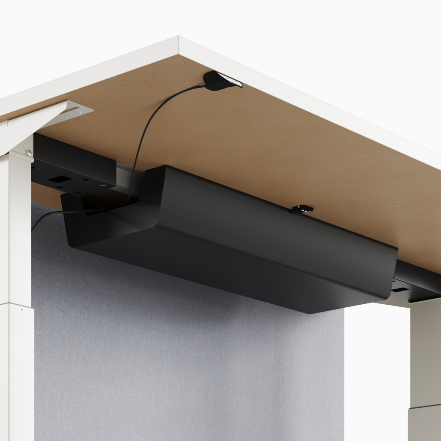 A close-up view of Nevi Link standing desk system's under-surface cable tray.
