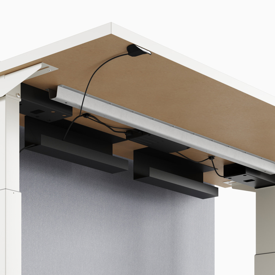 A close-up view of Nevi Link standing desk system's under-surface cable trough.