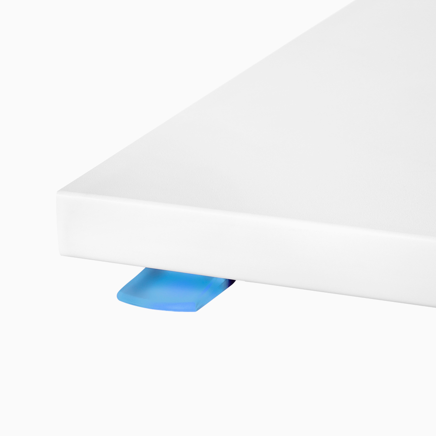 A close-up view of Nevi Link standing desk system's intuitive paddle, lit up blue.