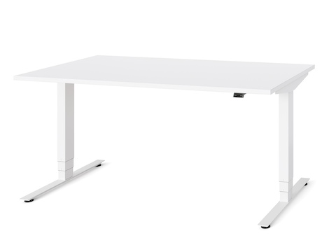 A white Nevi Sit-Stand Desk at seated height, viewed at an angle.