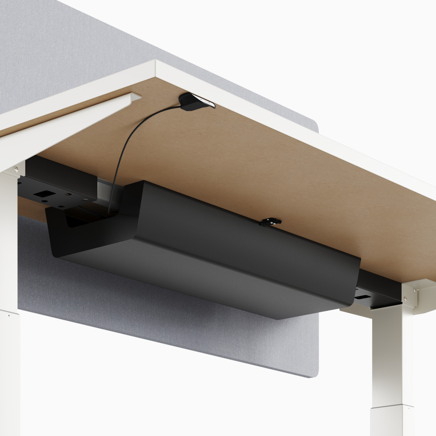 A close-up view of Nevi standing desk's under-surface cable management.