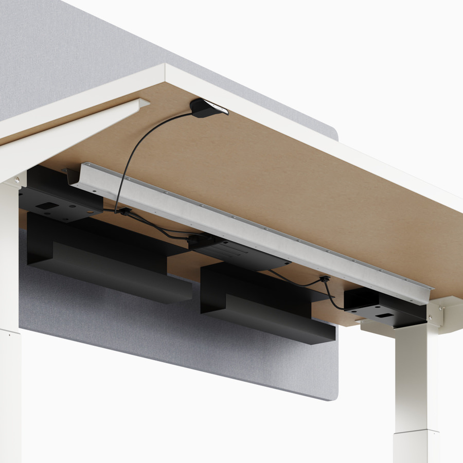 A close-up view of Nevi standing desk's under-surface cable trough.