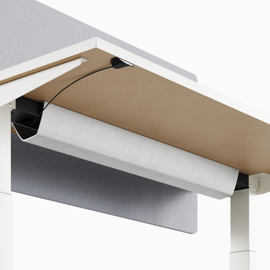A close-up view of Nevi standing desk's under-surface cable tray.
