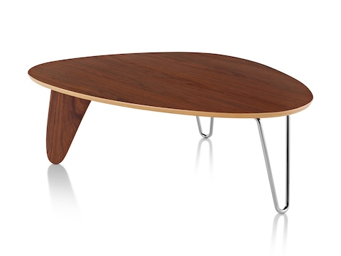 A Noguchi Rudder Table with a walnut finish.