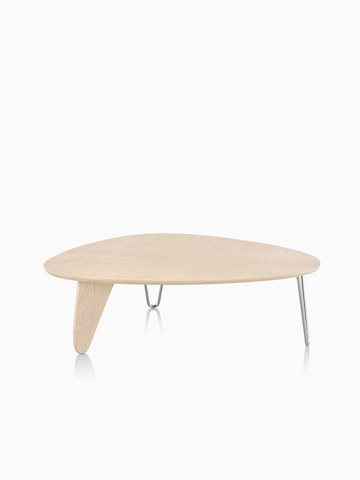 A Noguchi Rudder Table with a light wood finish.