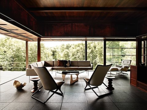 A Noguchi Table with a white ash base anchors a residential setting filled with mid-century modern pieces.