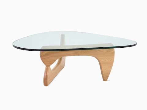 A Noguchi occasional table with a freeform glass top and curved wood base.