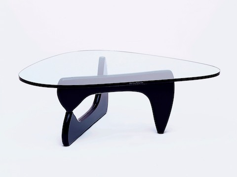 A Noguchi occasional table, showing Isamu Naguchi's signature on the edge of the glass top.