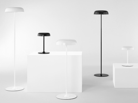 Three white and two black Ode Lamps, including table, sofa, and standing-height floor models.