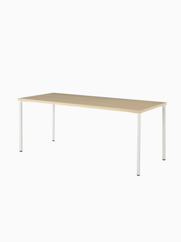 OE1 Rectangular Table with light brown surface and white legs viewed from an angle.