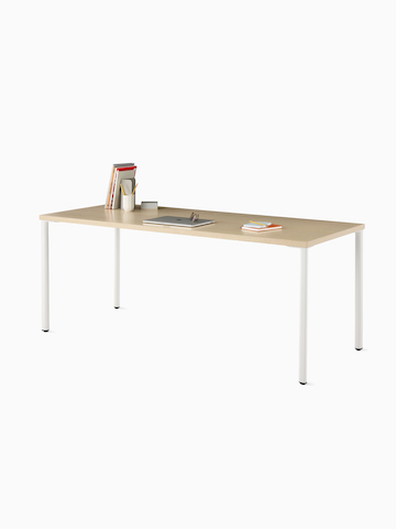 OE1 Rectangular Table with light brown surface and white legs.
