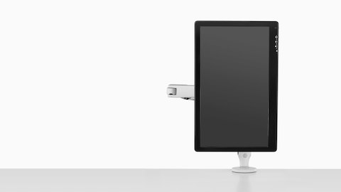 Front view of a monitor suspended in portrait orientation by a single light gray Ollin Monitor Arm.