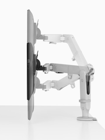 Profile view of an adjustable Ollin Monitor Arm positioning a monitor at three different heights.