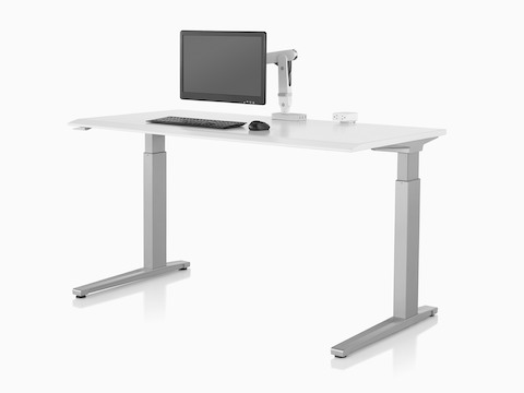 An Ollin Monitor Arm elevates a monitor off the surface of a sit-to-stand table.