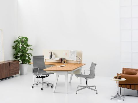 Optimis L-shaped table executive Haven setting with Eames Aluminum Group high back and mid back chaira. Wireframe Sofa with Nelson Pedestal side table.