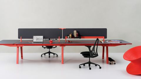 Optimis Bench table with add-on screen and two ended extension worktop surfaces with two graphite Sayl Chairs.
