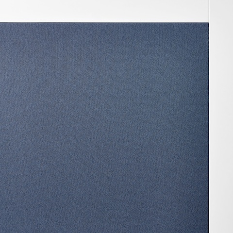 A close-up of dark blue fabric on Overlay's white structure.