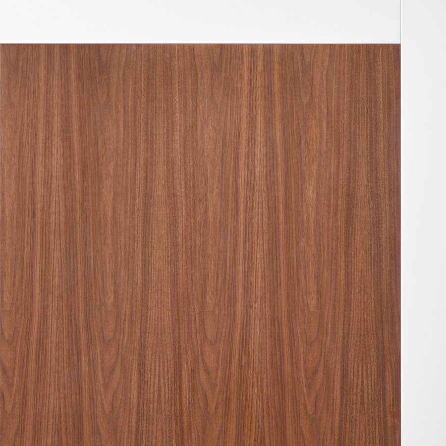 A close-up of walnut woodgrain laminate on Overlay's white structure.