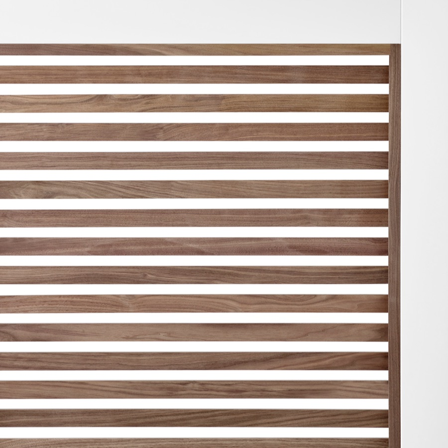 A close-up of walnut wood slats on Overlay's white structure.