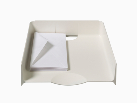A putty-colored Paper Tray containing a small stack of envelopes.